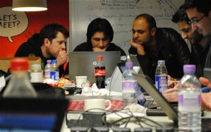 Developers & engineers look over data at Flood Hack [photo bbc.co.uk]